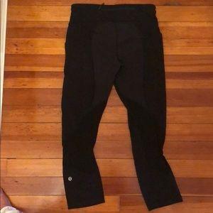 Black lulu lemon leggings with side pockets